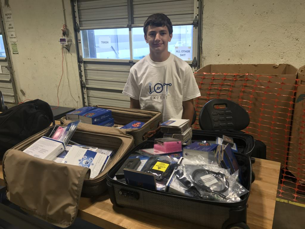 Nicholas with the pile of Cypress Development Kits